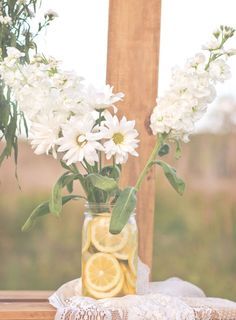Mason Jar filled with lemon slices, Daisies, & snapdragons Photograph by Captured by Belinda http://www.storyboardwedding.com/my-favorite-shoot-to-date-throw-back-lazy-summer-days-lemonade-stand-crush-worthy-engagement-photos/