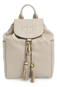 Love the tassels on the Tory Burch backpack.