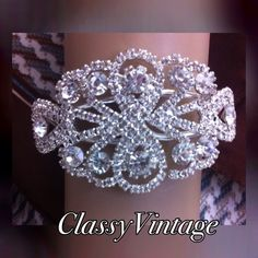 Silver and Chrystal bracelet. Beautiful spring lock  silver tone metal bracelet. Encrusted in Chrystal. These are my pics of item Sophia Jewelry Bracelets
