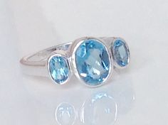 A personal favorite from my Etsy shop https://www.etsy.com/listing/480258765/blue-topaz-ring14k-blue-topaz-ring3