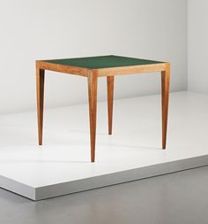JEAN ROYÈRE Game table, circa 1950  Oak, leather. 67 x 75.2 x 75 cm (26 3/8 x 29 5/8 x 29 1/2 in.)