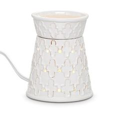 """Stylish embossed pattern echoes the lines of Mediterranean garden tiles for an adventurous, exotic air. Electric warming plate diffuses the fragrance of Scent Plus® Melts or scented oil, sold separately. Hidden LED light provides soft illumination. Glazed ceramic with white cord. 5 1/4""""h, 4 1/4""""dia."""