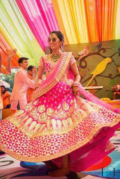 Fuschia pink lehenga , twirling bride, bride with sunglasses, gota patti lehenga