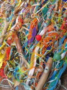Jo Atherton, @flotsamweaving, lives in the UK and collects #litter from Sheringham, Norfolk on the East Anglian coast. She creates art from littered fishing line, twine, nets and other random plastic objects.  See her work at http://www.flotsamweaving.com and follow her on twitter @FlotsamWeaving and like her Flotsam Weaving Facebook Page.  2013-09-10 12.32.11