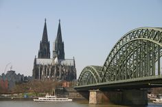 Cologne Cathedral looms over the city's Hohenzollern Bridge, Germany