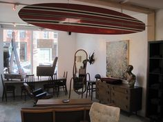 i have got to dig out my surfboard from the deep recesses of the basement and hang it somewhere. in no way is it cool as this one