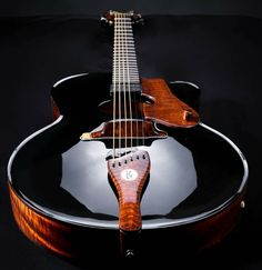 De La Garza  This guitar looks like a burst of crimson knighted love. This is beautiful