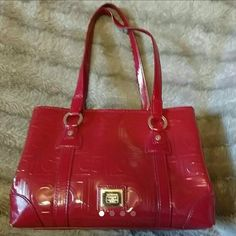 """Liz Claiborne Purse Gorgeous Bright Red Purse with a  Liz Claiborne Bow Charm! The inside is perfect - no rips, stains or holes! There are 3 openings to this Purse -  1 rather large in the center, 1 snapping magnetic opening & closings on each side - 1 snap side has a large zipper pouch, the other side that snaps has 3 open compartments - measures 12 1/2"""" x 9"""" not including straps, 12 1/2"""" x 18"""" with straps. Edges on bottom do have wear- see last picture. Silver Toned accents and quite…"""