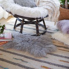 It's cozy. It's soft. And it's so hot right now! Our fur and faux fur finds like Sheepskin Rugs and plush Faux Fur Pillows are part of the layering trend that's taking home decor by storm. Fur and Faux for All: Our Top Sheepskin Trends World Market Rug, Rug World, Cost Of Carpet, Fur Pillow, Pillows, Affordable Rugs, Sheepskin Rug, Trends, Home Rugs