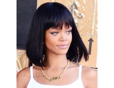 @Byrdie Beauty - Rihanna's new Cleopatra cut—blunt bangs and thick mid-length hair—matches the Egyptian-inspired tattoo on her chest.
