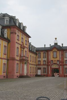 The Palace of Bruchsal in Germany. Bruchsal Palace was constructed in 1720 as a residence for the Prince-Bishops of SpeyerThe three-wing palace is built of sandstone. The collection of exquisitely matched buildings, along with the carefully laid out garden, make up an extraordinarily beautiful ensemble. http://www.schloss-bruchsal.de