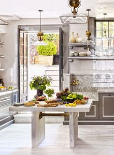 """""""To make this space feel lighter, I wanted to be able to see through the island,"""" says Gambrel of his own New York City kitchen. """"This one was inspired by an industrial factory table from the late 19th century. Because it's made of the same material as the flooring—reclaimed marble from the old façade of Manhattan's Henry Phipps mansion—it almost disappears."""" 