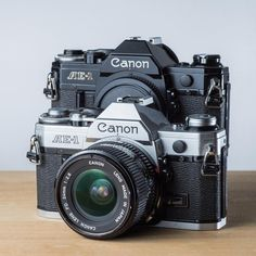 What do you prefer; all black or part chrome cameras? #canon #canonae1 #shootfilm #filmphotography #camera #cameragear #35mm