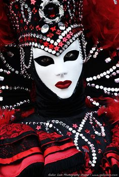 Venice Carnival 2011...a dramatic red, black, white, and silver costume and mask