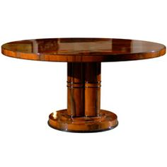 Art Deco Round Dining Table | From a unique collection of antique and modern dining room tables at https://www.1stdibs.com/furniture/tables/dining-room-tables/