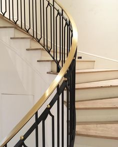 design by jenkins interiors | curved brass and iron handrail | custom design by jerkin interiors