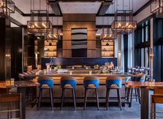 Meyer Davis Studio best bar interior design ideas | Remedy bar at Veil Colorado with wood bar stools with upholstered backs | Discover more bar and restaurant inspirations at http://counterandbarstools.eu/category/see-by-room/bar-and-restaurant/
