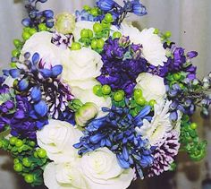 A mix of blue and ivory flowers in a bouquet fit for a princess