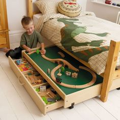 Play table in under-bed storage. and the appliqued dinosaur bed is radical awesome. Train Table, Play Table, Lego Table, Under Bed, Bed Storage, Storage Ideas, Table Storage, Playroom Storage, Storage Solutions