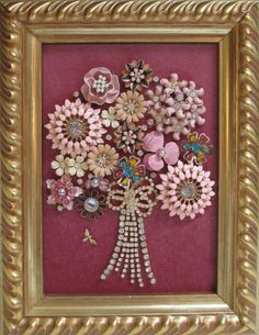 This piece is fabulous! Measuring approximately 9 X 7 inches from the outside edges of the detailed gold tabletop frame with easel backing and wall hooks. Soft rose velvet embellished with multiple vintage and contemporary elements make up this lovely bouquet. Perfect gift or for your own home. The bouquet that lasts forever! Unique, up-cycled, handmade and one of a kind. Thank you for looking! Please note: Piece is shipped as shown in frame pictured however the frame can be exchanged later…