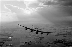 A very dramatic shot of the Mynarski Lancaster thundering out of stormy skies. One could imagine this to be a lone Lancaster flying over Kent as the sun comes up on the way home from a long night bombing mission. Photo by Eric Dumigan Air Force Aircraft, Ww2 Aircraft, Lancaster Bomber, Airplane Fighter, Aircraft Photos, Ww2 Planes, Royal Air Force, Air Show, Royal Navy