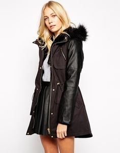 Oasis Premium Faux Fur Hood Parka - Black, Coat by Oasis Durable woven fabric Soft fluffy interior lining Detachable faux fur trim Leather-look sleeves Drawstring waist Side pockets Press stud and zip fastening Regular fit - true to size Machine wash 55% Cotton, 45% Polyester Our model wears a UK 8/EU 36/US 4 ABOUT OASIS Creating collections with focus on feminine tailoring, quality cuts and wearable designs, high street brand Oasis deliver every season.