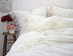 Cozy floral bed.  Shabby Chic bedding collection.  Pretty florals.