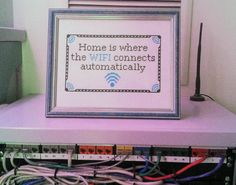 """""""Home is where the wifi connects automatically"""" cross-stitch!  I'm not typically a fan of cross-stitch, but I want one!"""