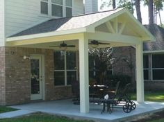 "Covered patio with arch roof.  Might be a good option for a ""pergola""."