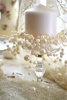 Fripperies:  Candle with pearls and lace.