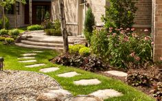 Reuse existing flagstone as stepping stones in grass to shed