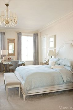 soft tones.  Elegant traditional master bedroom, white with soft blue accents, high windows, great trim and panelling.  Beautiful