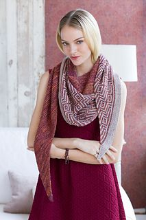 See garter stitch that is knit in a solid color from the smallest point and bias shaped through the two-color mosaic segment create the fluid and body-draped fit of this unique shawl.