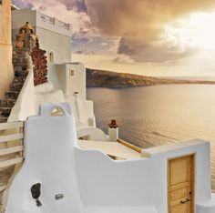 Typical villa overlooking the caldera at dusk in Oia