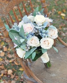 Blush apricot roses, vanilla roses, dusty miller and eucalyptus in silk flowers with dried brunia in this wedding bouquet by Holly's Wedding Flowers. See more here: http://www.hollysweddingflowers.com