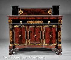 An American Classical Carved Mahogany, Ebonized and Gilt Stenciled Sideboard, c. 1825, attributed to the workshop of Joseph Meeks and Sons