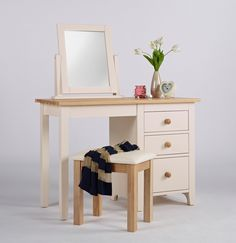New England Painted Single Pedestal Desk This is a beautiful desk/dressing table  Clean fresh lines and lightly painted in ivory  It has three deep drawers The drawers are tongue and groove With contrasting wooden knob handles The top is solid ash that has been lightly lacquered This is a satin finish which is resilient and serves to protect the natural beauty of the ash The frames are solid pine With high quality MDF panelling Finished in a knock resistant paint in ivory
