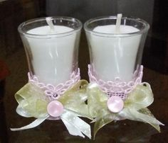 Hand poured candles in shot glasses decorated with pink lace and beads and green ribbons