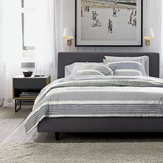 A mid-century modernist's dream. Streamlined, low platform design is wrapped head to toe in a textural charcoal weave, treated with fabric protection and punctuated with retro button tufting on the headboard. Dark tapered legs take a minimal stance. Platform bed designed for use with mattress; no foundation required.