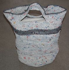 Crocheted plastic bag laundry basket bag. This project requires at least 170 recycled plastic bags.