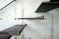 Contemporary Stairway...Ingenious use of metal & concrete...floating steps!