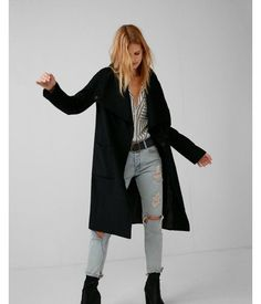 Made from a soft mid-weight wool blend, this sleek cocoon coat lets you enjoy winter-ready warmth without the bulk. It has a silky lining and roomy pockets, as well as a snap front that lets you choose between an open drape or funnel neck silhouette.