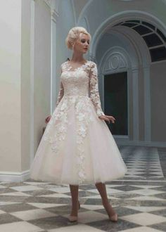 Love love love this dress the lace flower detail is gorgeous.  The sleeves!