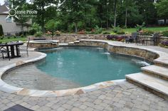 retaining wall pool Freeform Pool Spa with Stone Retaining Wall Pool Spa, My Pool, Swimming Pools Backyard, Swimming Pool Designs, Pool Landscaping, Pool Outfits, Pool Retaining Wall, Pool Remodel, Backyard Pool Designs