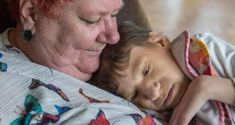 Johanne holds Siobhan who  cannot walk, is non-verbal, does not eat solid food, is doubly incontinent, and has only one kidney. Photograph: Brenda Fitzsimons
