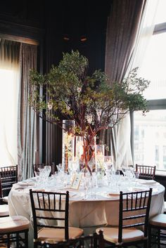 Tree/branch and candles centerpieces in dance hall.