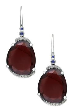 love the color of these garnets & the way they are set with the tiny sapphires at the top...so pretty