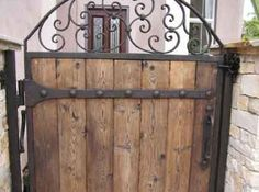 Beautiful Metal Gates With Wood Infill and metal and wood drive gates