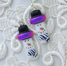 snowmen. Maybe could interpret with a domino for ornament.