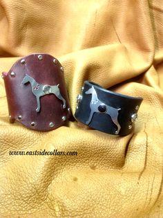 Leather cuffs & Doberman.  www.facebook.com/eastsidecollarsny
